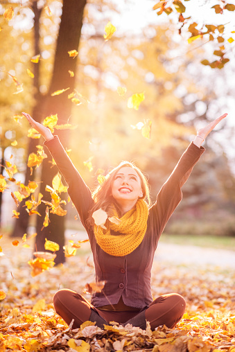 girl-throwing-fall-leaves-appreciate-the-journey.jpg