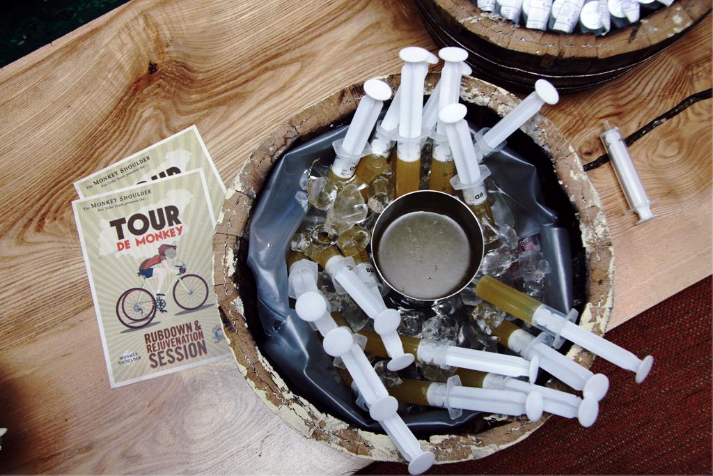 Serving syringes of whisky cocktails for a Tour de France event