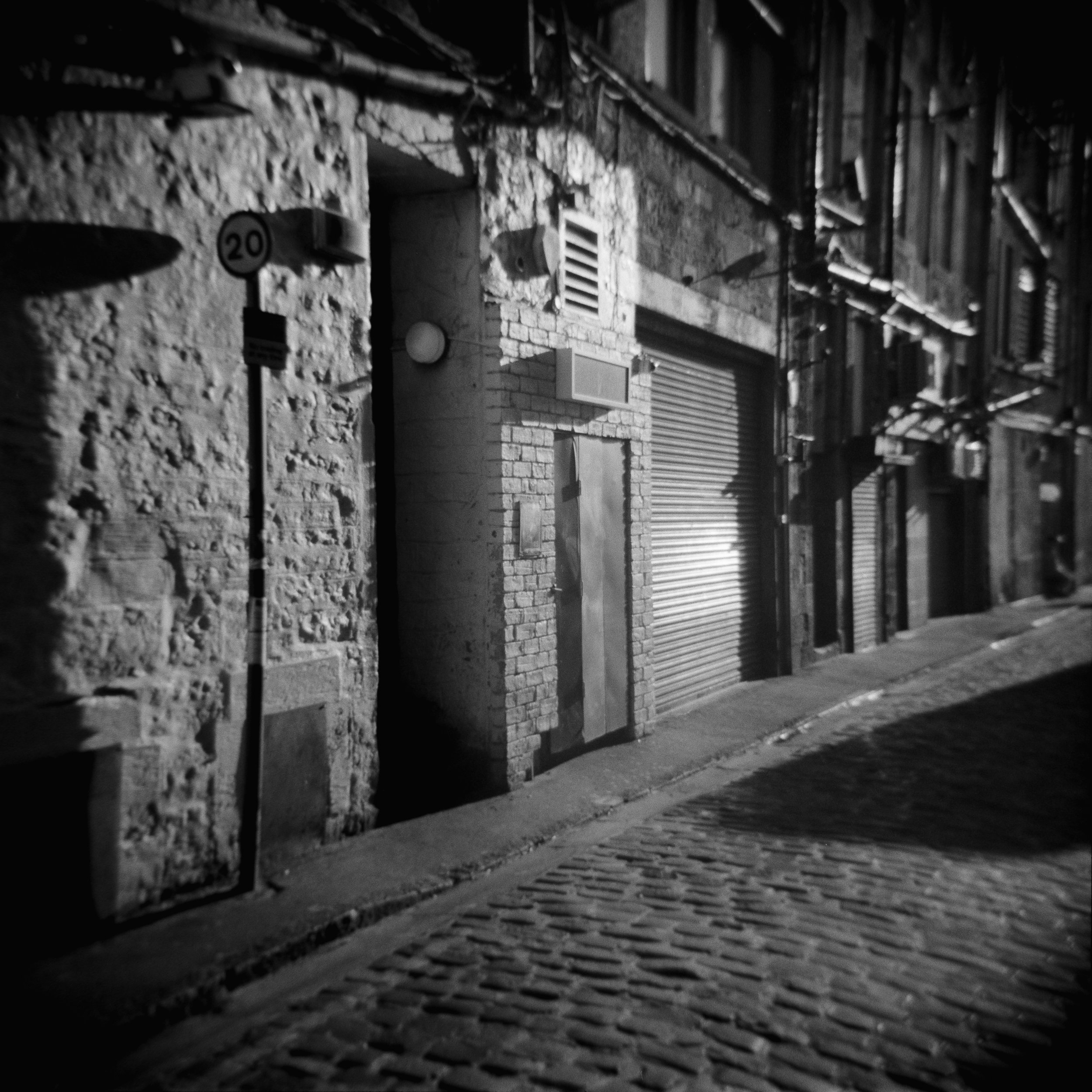This is what happens when you expose for the highlights with an ancient camera (an Agfa Super Isolette from the 1950s). I might to have to get it checked out as it's usually very sharp and doesn't distort quite this much but on the other hand there's an awful lot of straight lines in the frame, many in the out of focus areas which will advertise any problems.  As an aside it's also my first foray into DSLR scanning, seems to be working well and it's super fast compared to a flatbed. If you use an iPad instead of a light box like this scan the pixels give you a fairly neat newsprint type effect.