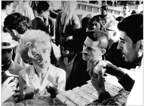 """Israeli tourists shopping in the newly occupied territories. David Rubinger, 1 July 1967.  R.L. Stein.November, 2008. """"Souvenirs of Conquest: Israeli Occupations as Tourist Events. """" International Journal of Middle East Studies ."""