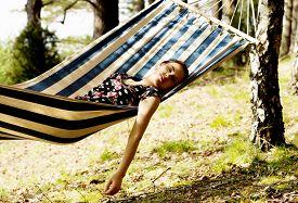 woman-relaxing-hammock-hot-sunny-day_cg2p56007263c_th.jpg