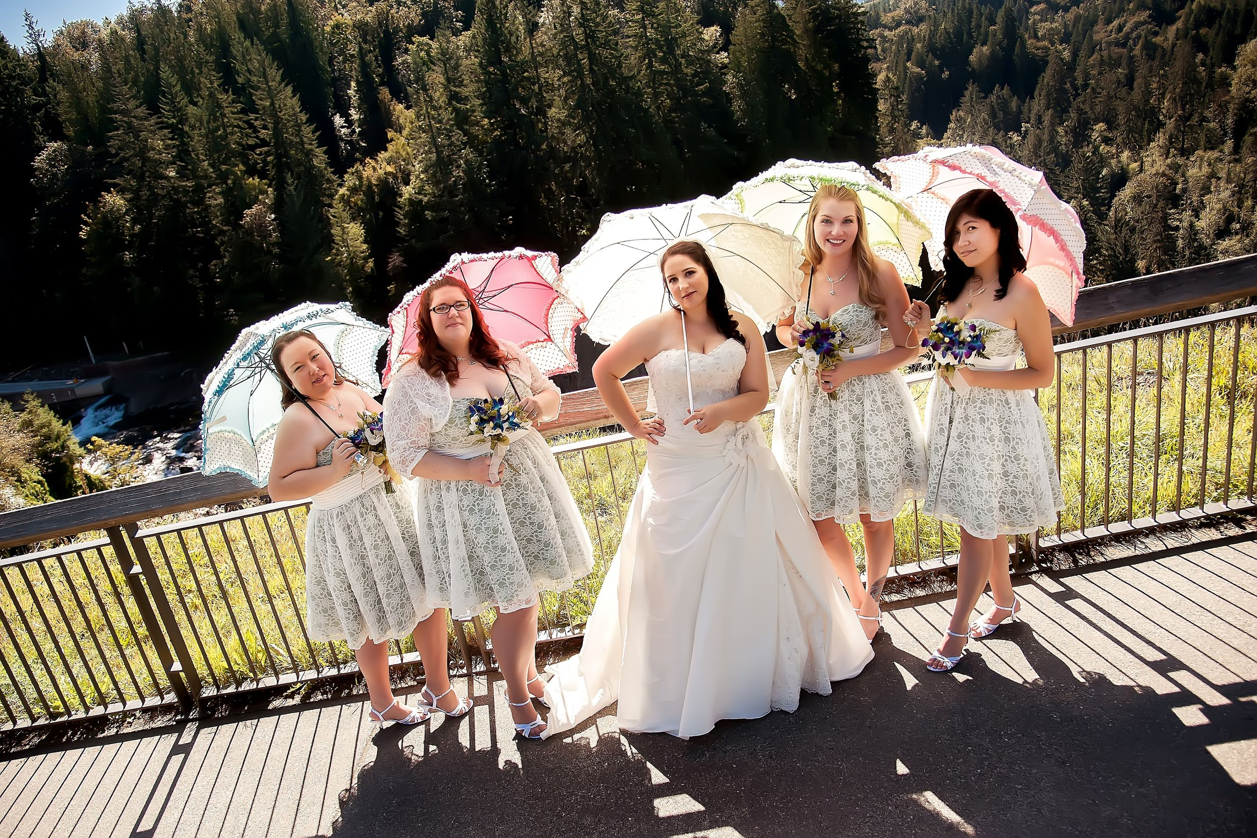 Bride & Bridesmaids with Umbrellas Looking Sassy.jpg