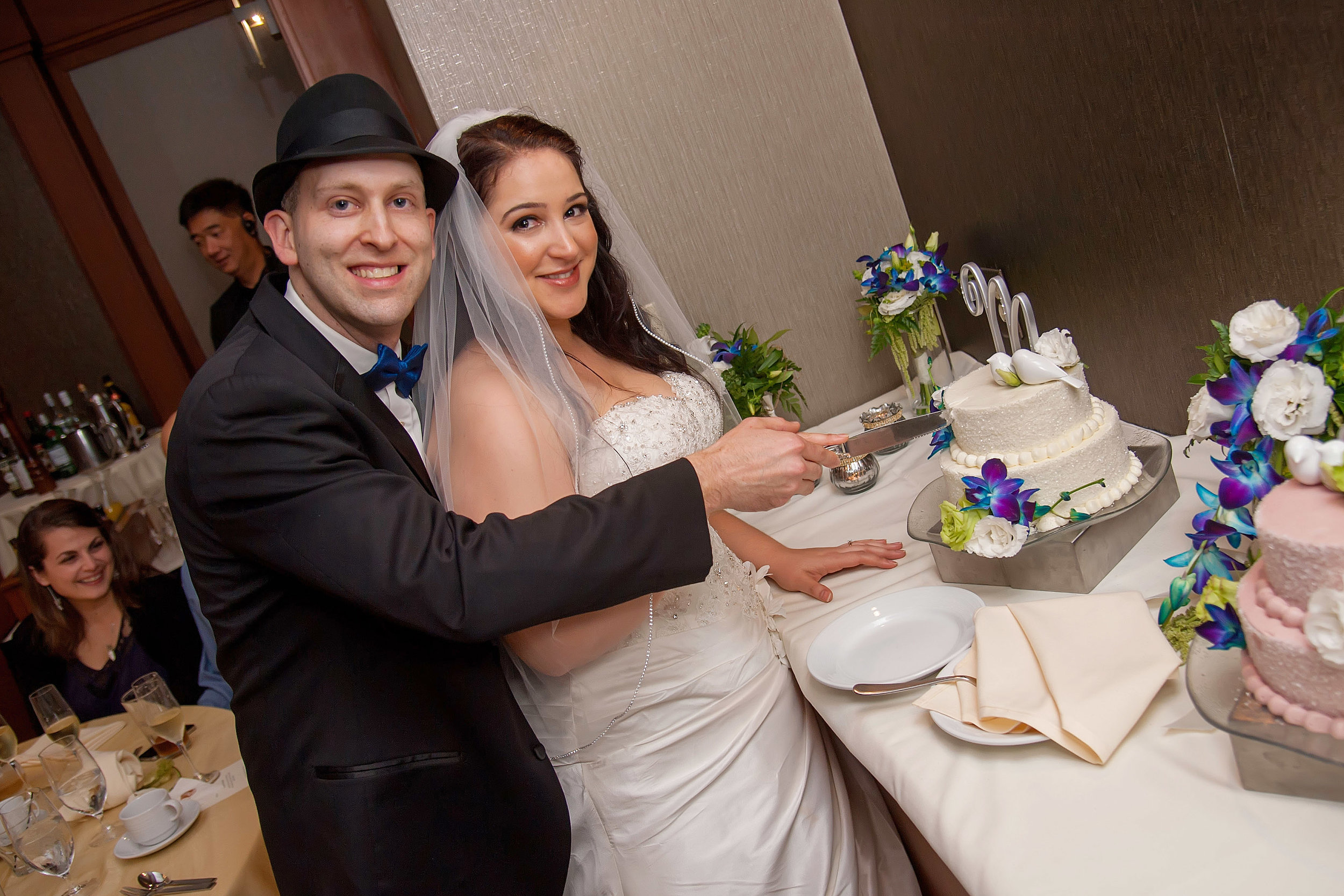 Bride & Groom Cutting Cake.jpg