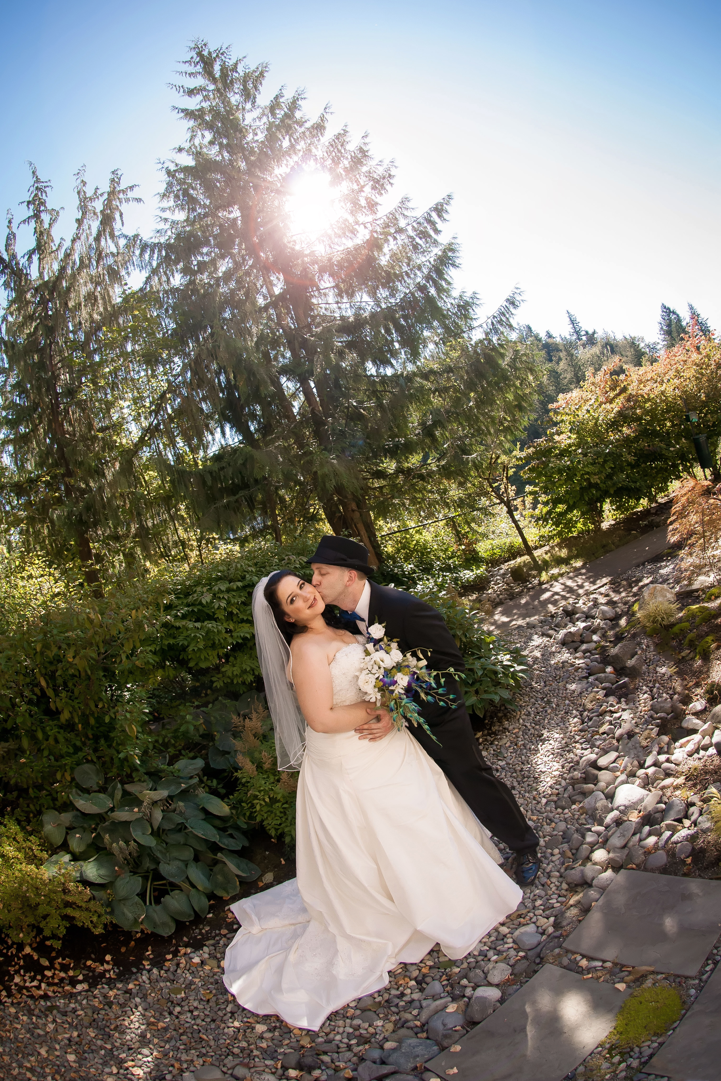 Bride & Groom Cheek Kiss Outside Garden.jpg