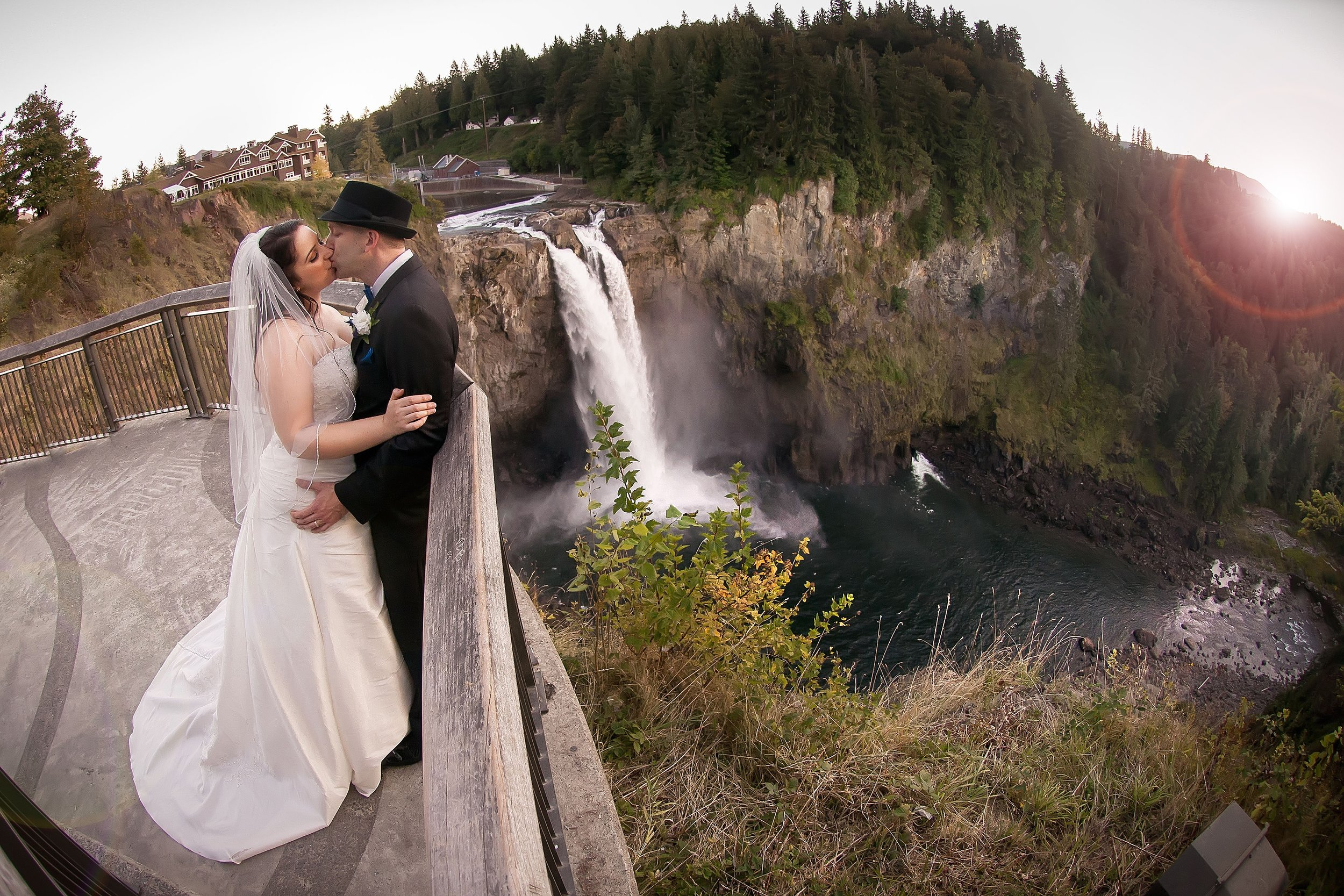 Bride & Groom Kiss by the Waterfall.jpg