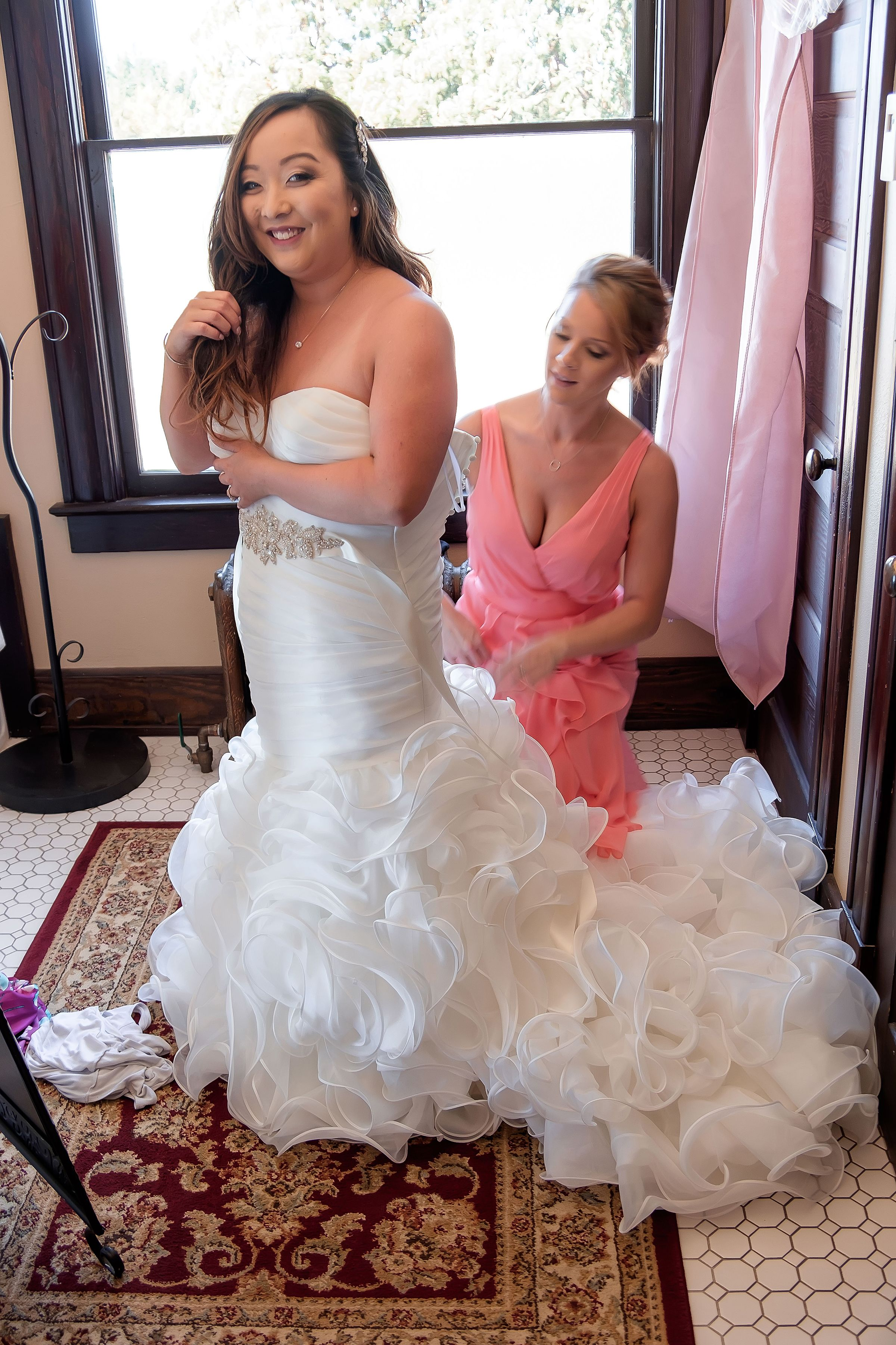 Bride getting into dress.jpg