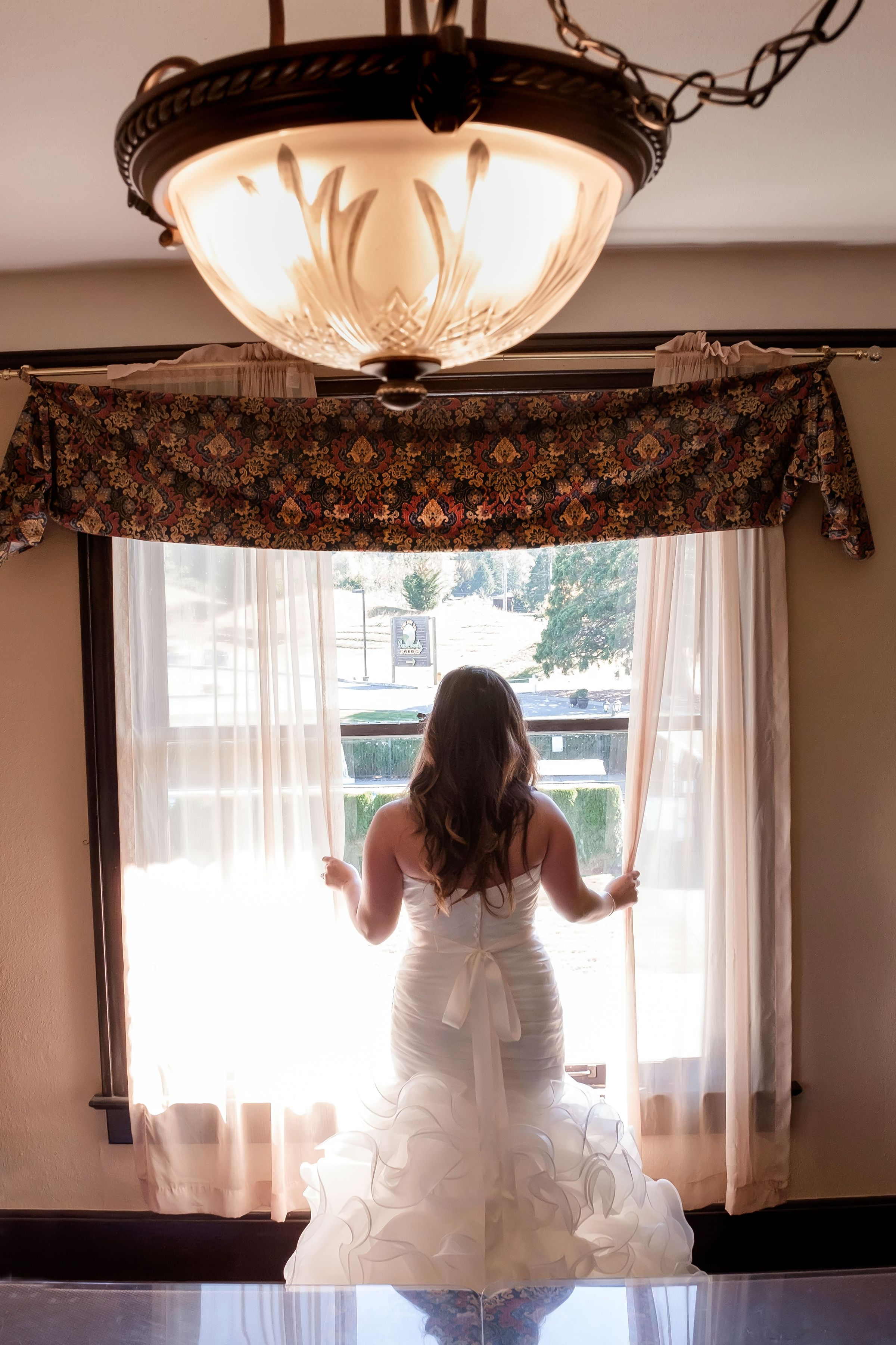 Bride looking out window.jpg