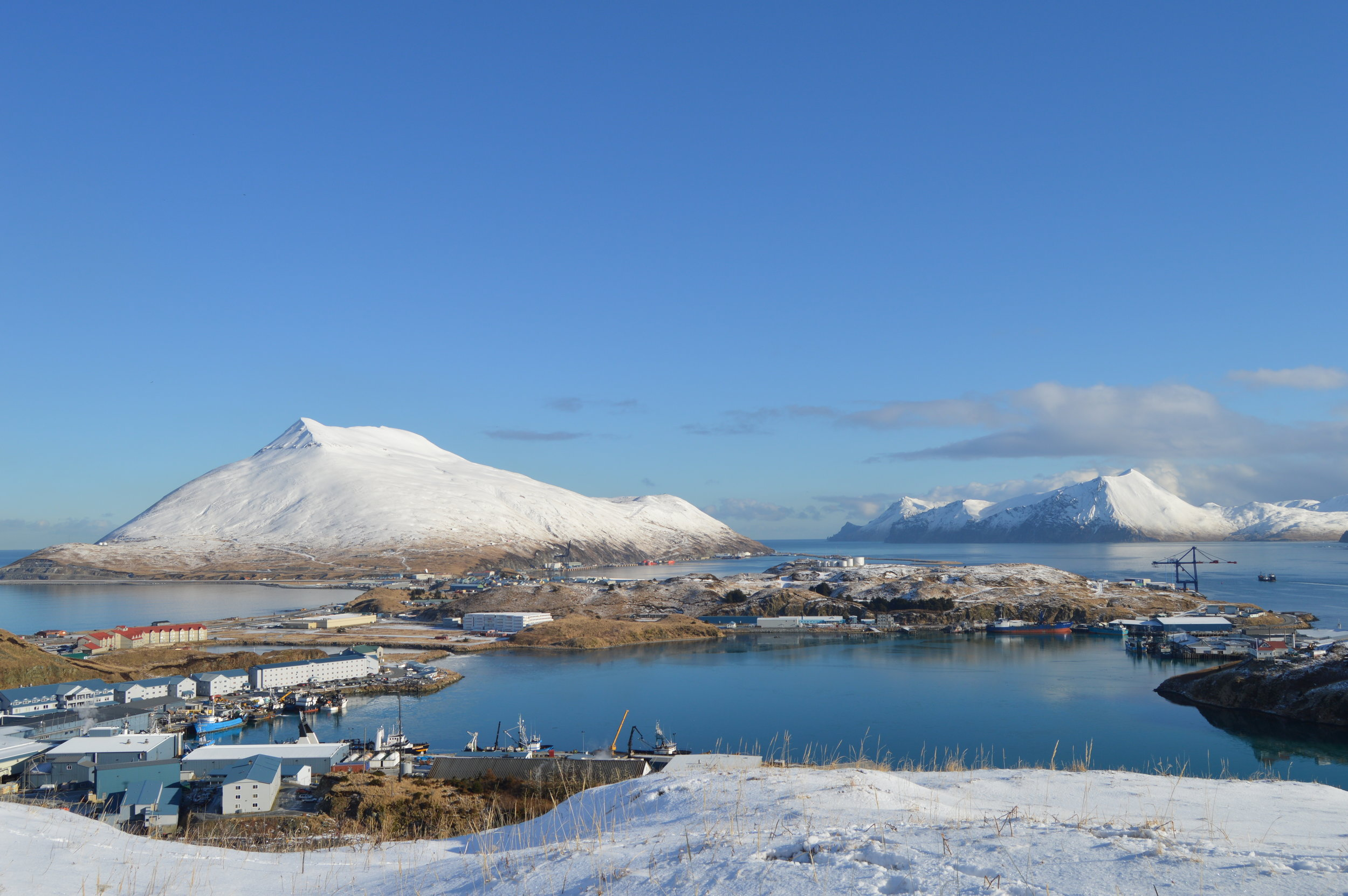 Port of Dutch Harbor in distance, city of Unalaska, Margaret Bay in foreground