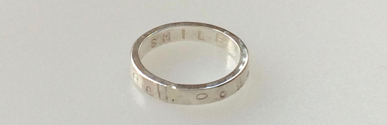 """Secret word ring: """"SMILE"""""""