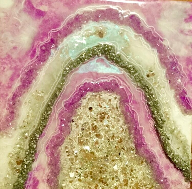 "Creating a Geode on canvas with resin- Saturday, December 14, 10:00am-1:00pm   Barb will guide you step by step to create your own ""Geode"" on a 10""x10"" canvas. You can choose your own color scheme.   Cost: $65/person"