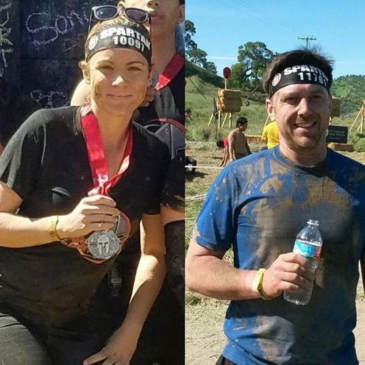 Sarah and tim showing off their Spartan race Medals