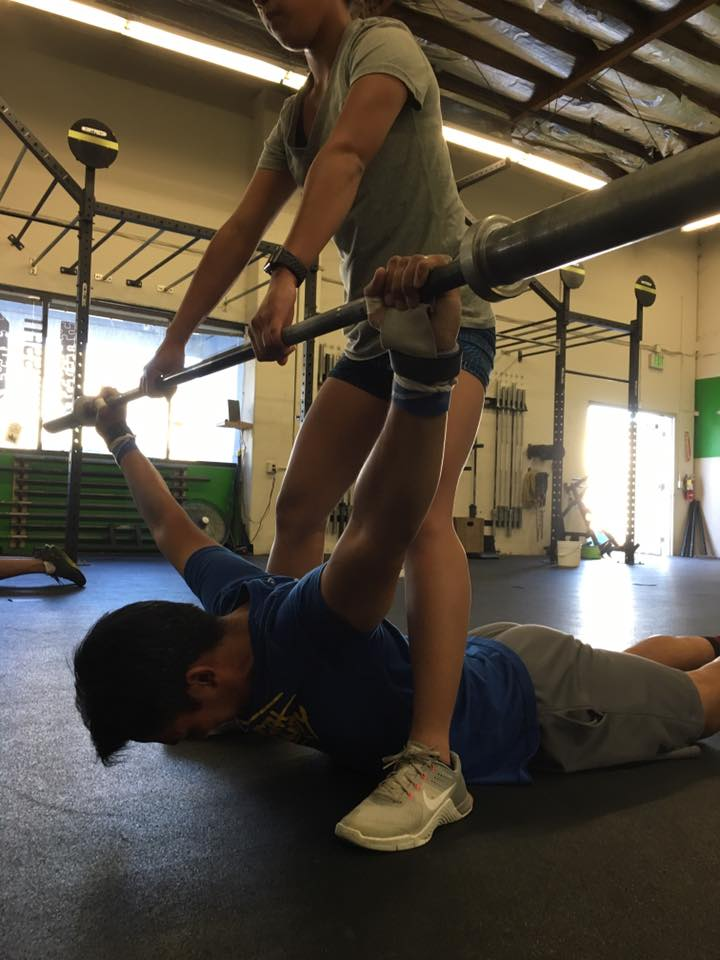 Denean helping Chris with shoulder mobility