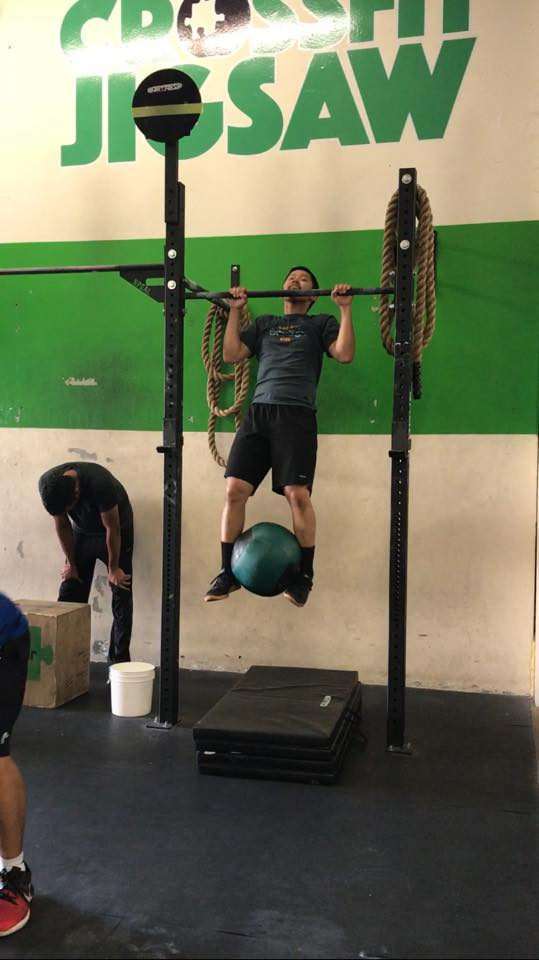 Jervie workinng on weighted pull-ups