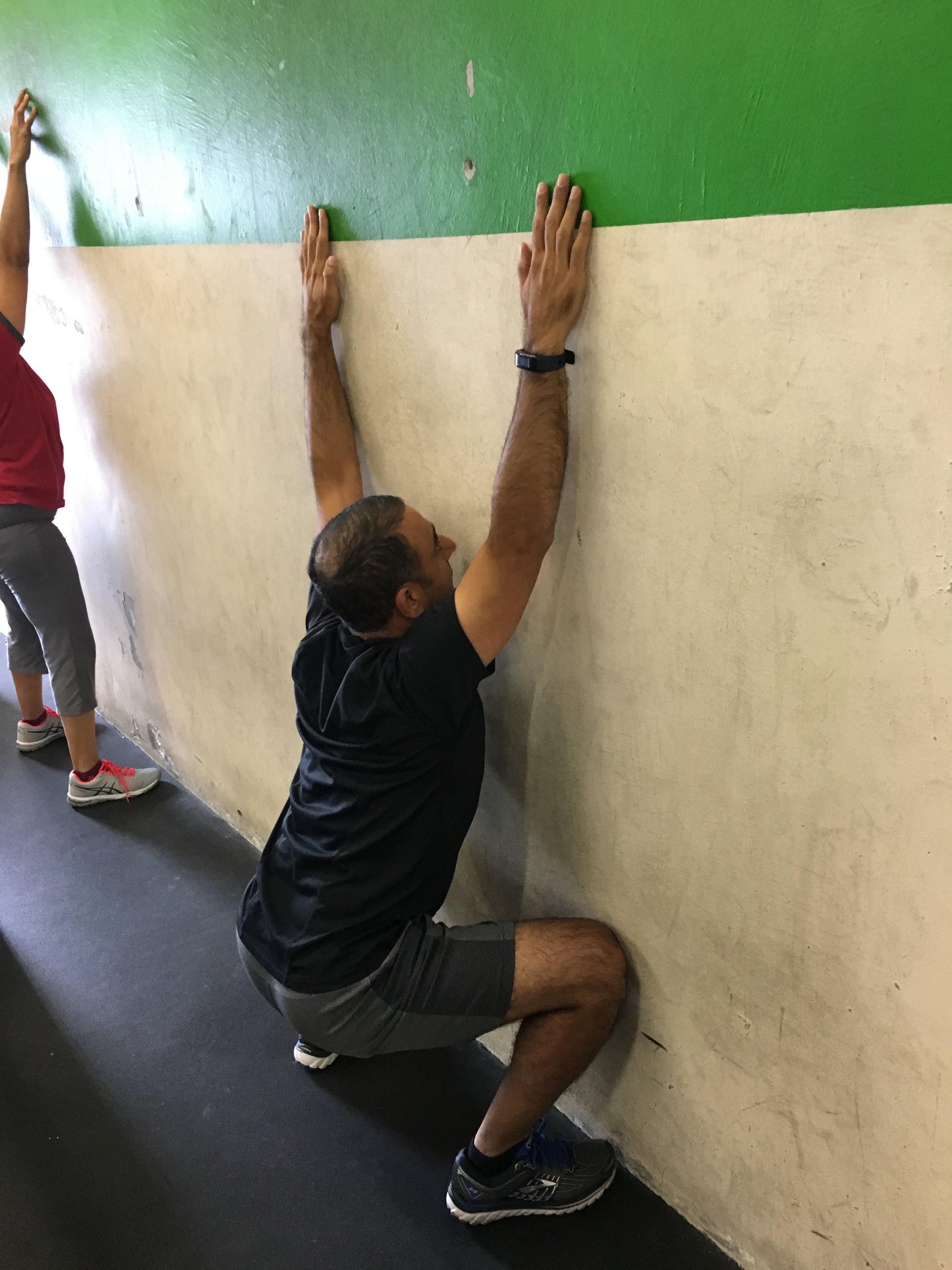 Ashish showing great range of motion and control with wall squats