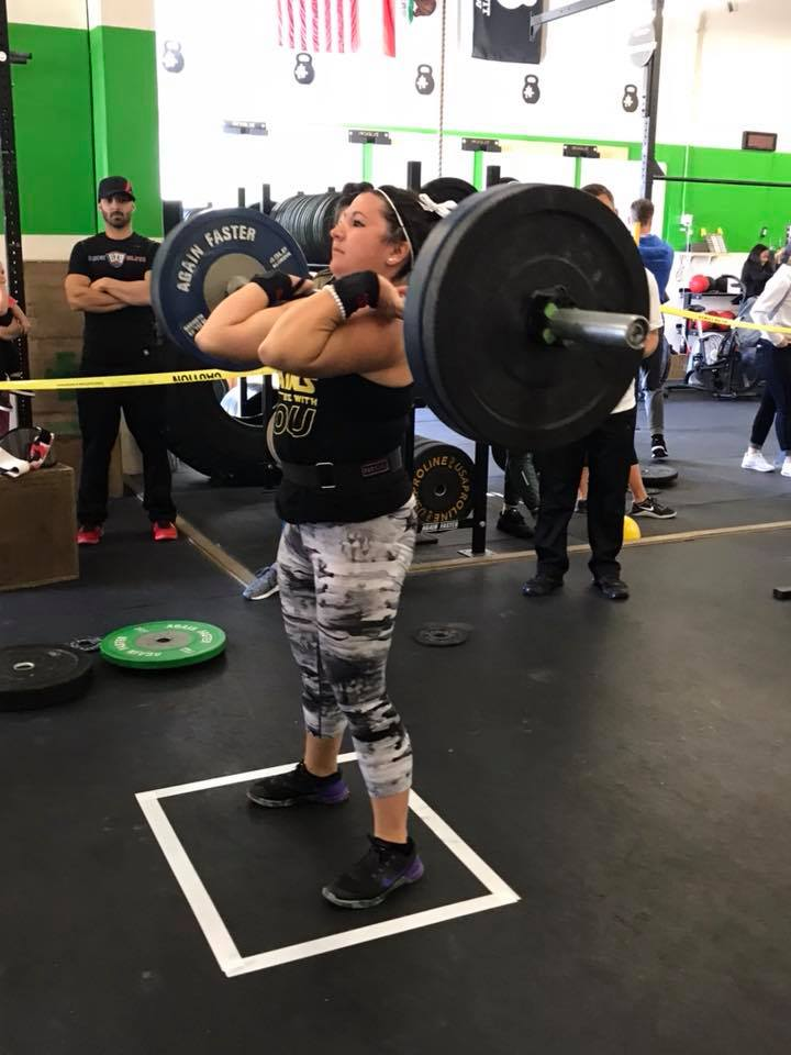 Mary lifting heavy during the Jigsaw Throwdown