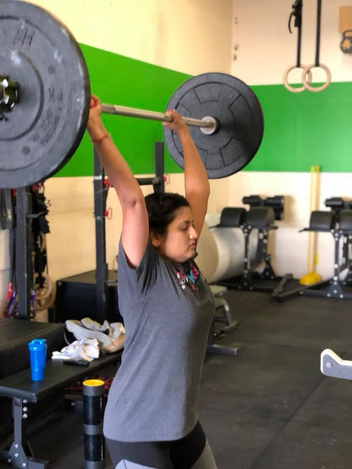 Nidhi working on her overhead movements