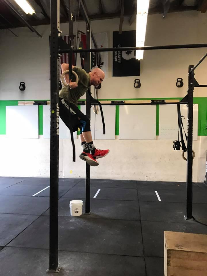 Paul making his muscle up attempt with a strong catch in the dip
