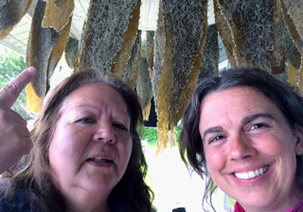Jenny Cross (left) and Shelly Crack (right) on Jenny's ocean-side porch where freshly caught fish are drying.  Source: Shelly Crack