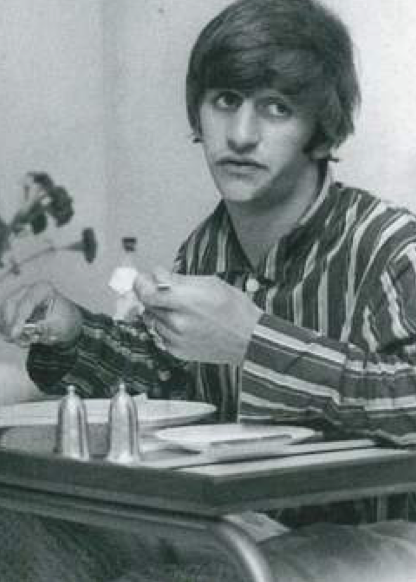 Ringo Starr does not seem pleased with his hospital meal.