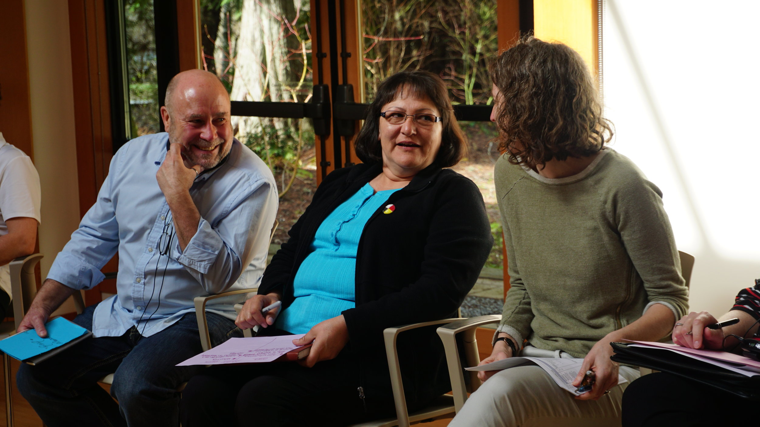 Dan Munshaw, Kathy Loon and Beth Hunter chat at the second cohort retreat in British Columbia in Spring 2018.