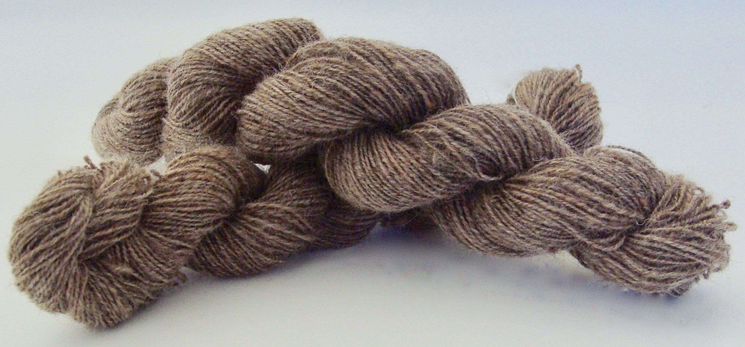 2 skeins of Romney wool 2-ply yarn for a total of 263 yards.