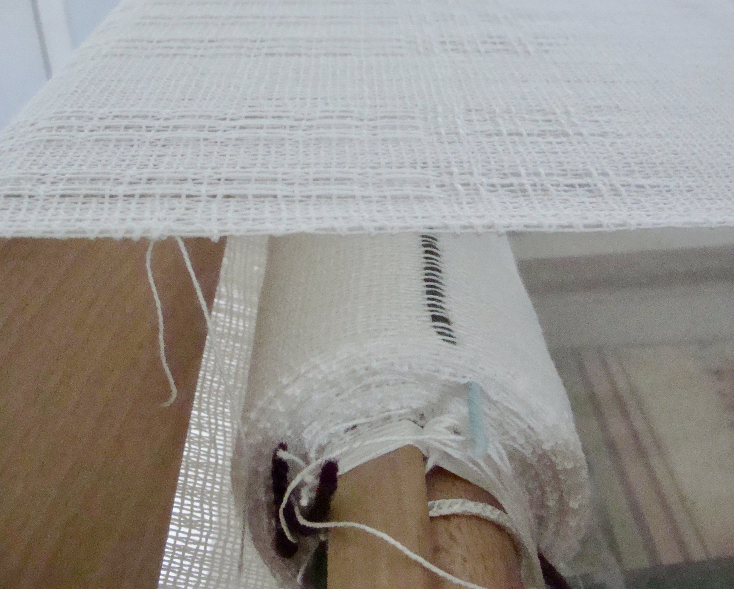woven towels rolling onto cloth beam