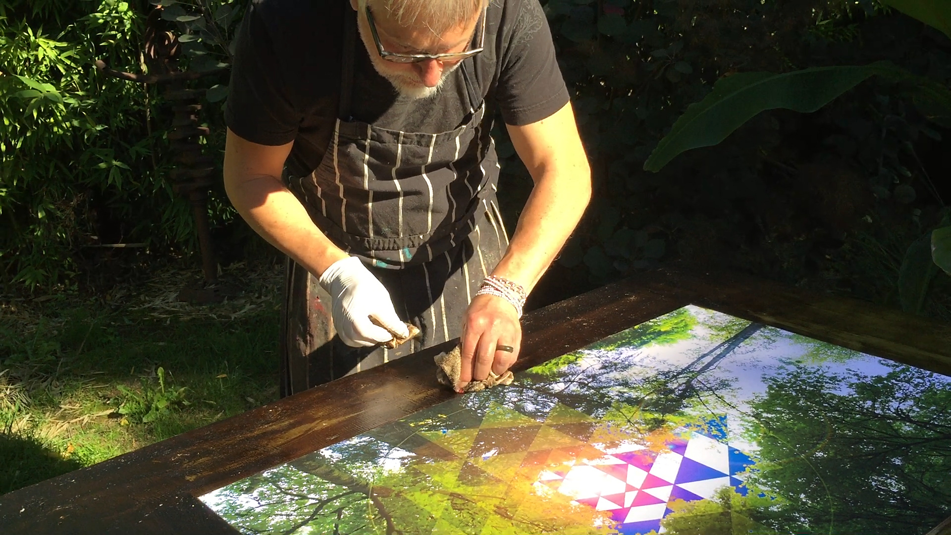 "Luce creating a gilded border on the ""tree chakra"" panel. 36"" x 48"" x 2"""
