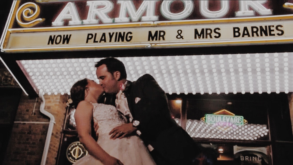 Wedding video sample image, couple kissing under Armour Theater