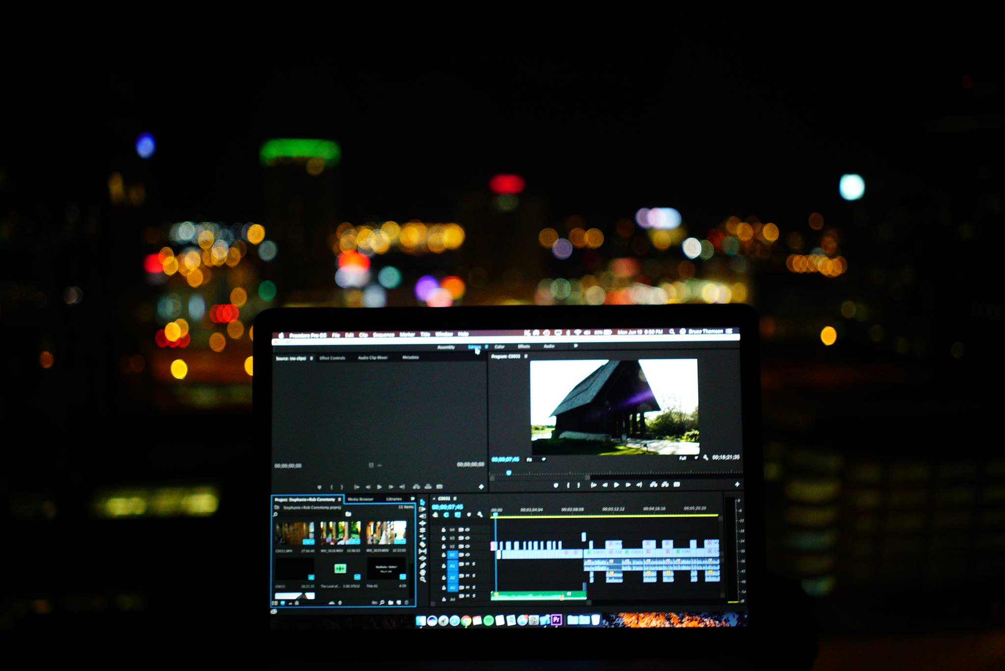 Commercial videography sample image, computer editing with lights in background