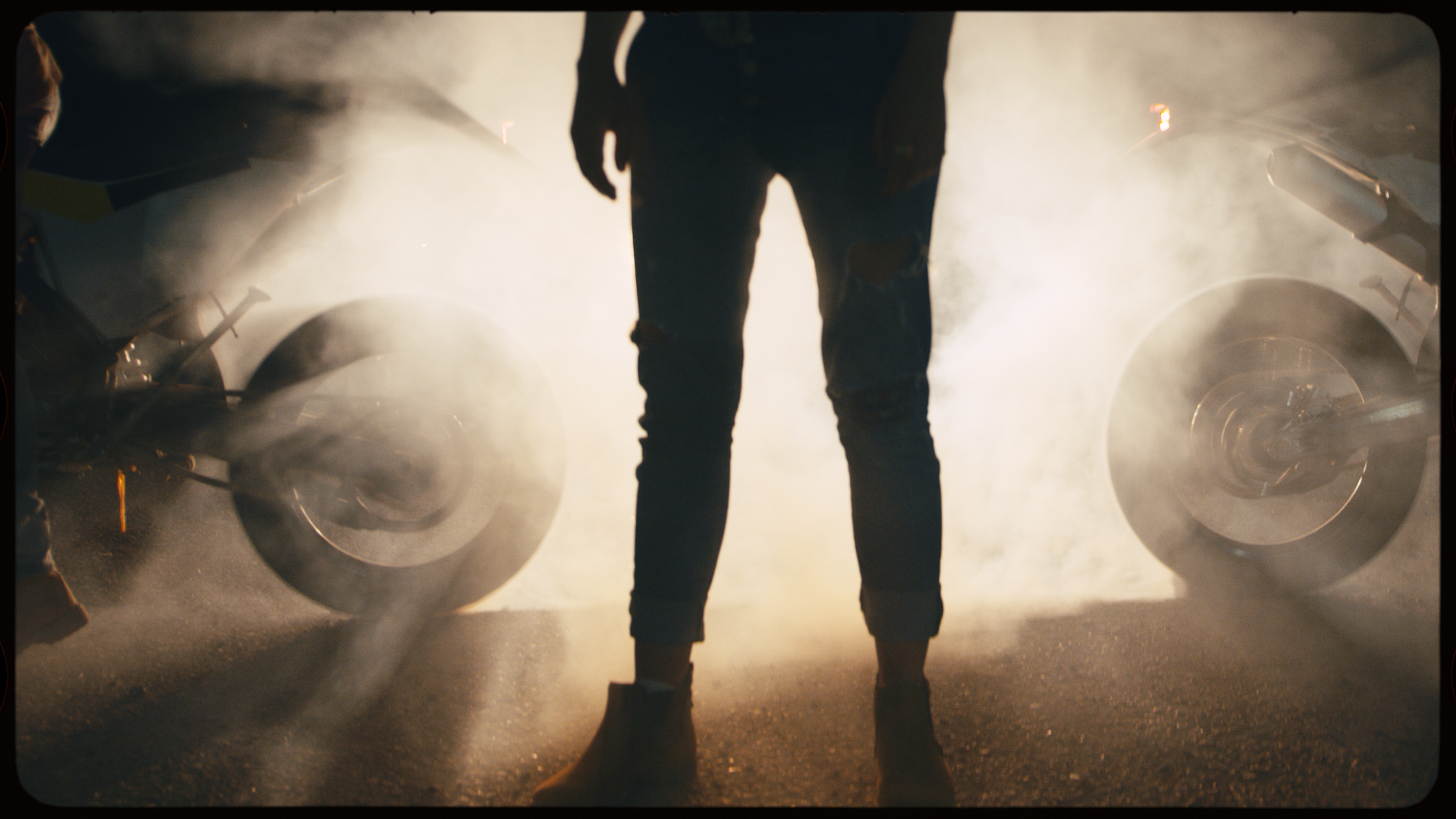 dirt bike rider performs wheelie in clouds of dust by Omri Ohana Artgrid.00_00_36_18.Still001.png