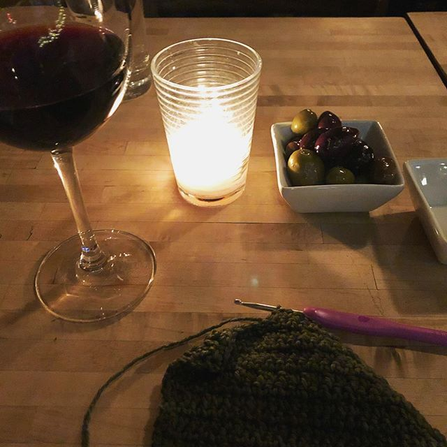 Had a couple of hours of baby-free alone time out in the world today and took full advantage (yay pedi!), capping it off with some crochet at the local wine bar before heading home for the baby bedtime ritual. Decided to play the odds and see if I could have red wine, oily olives, dim candlelight, and dark yarn and still crochet properly. I totally succeeded! 🙌 #momwin