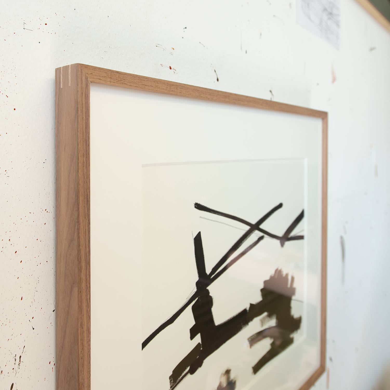 Walnut frame with contrasting spline corners