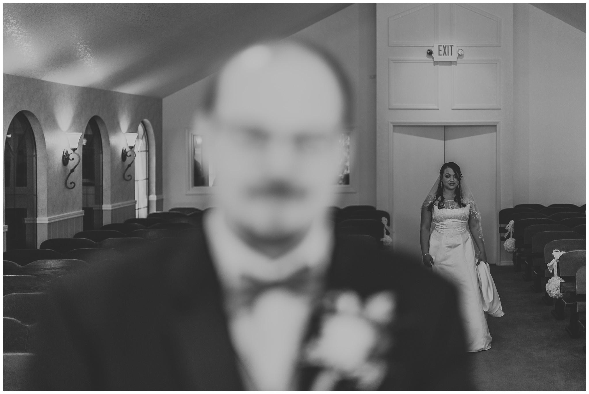 bride walking up behind groom for first look