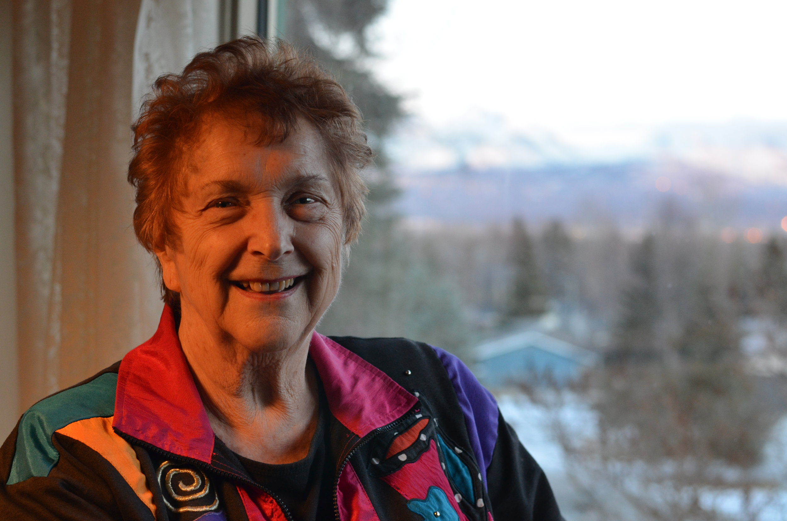 Conway at her home in Anchorage, with a view of the Chugach Mountains.
