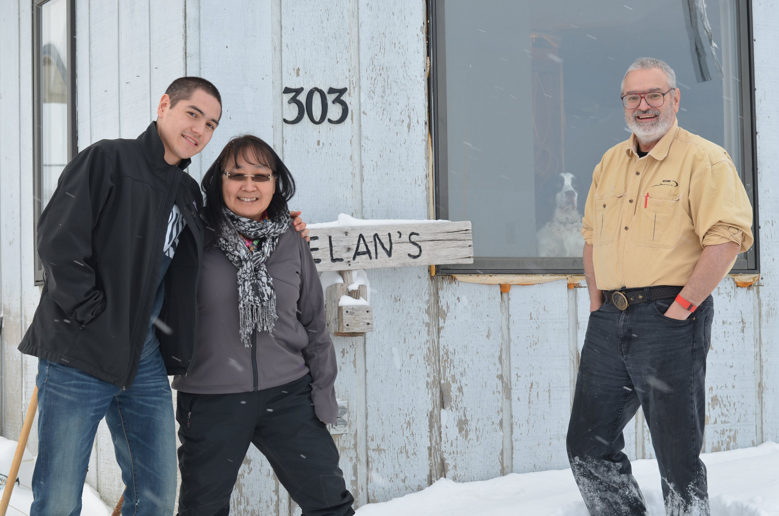 Koezuna-Irelan with son Jens and husband Hank, outside their home.