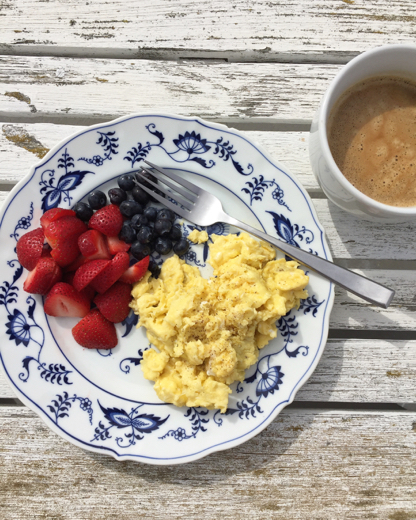 Pretty and pretty easy   ~    soft scrambled farmer's market eggs with fresh strawberries and blueberries along with a Califia Farms unsweetened almond milk cappuccino. Breakfast doesn't have to be hard, but can be hearty. Heat olive oil on medium / low heat and slowly scramble eggs until softly formed, don't overcook. Season with salt and pepper. Add avocado for a yummy fat.
