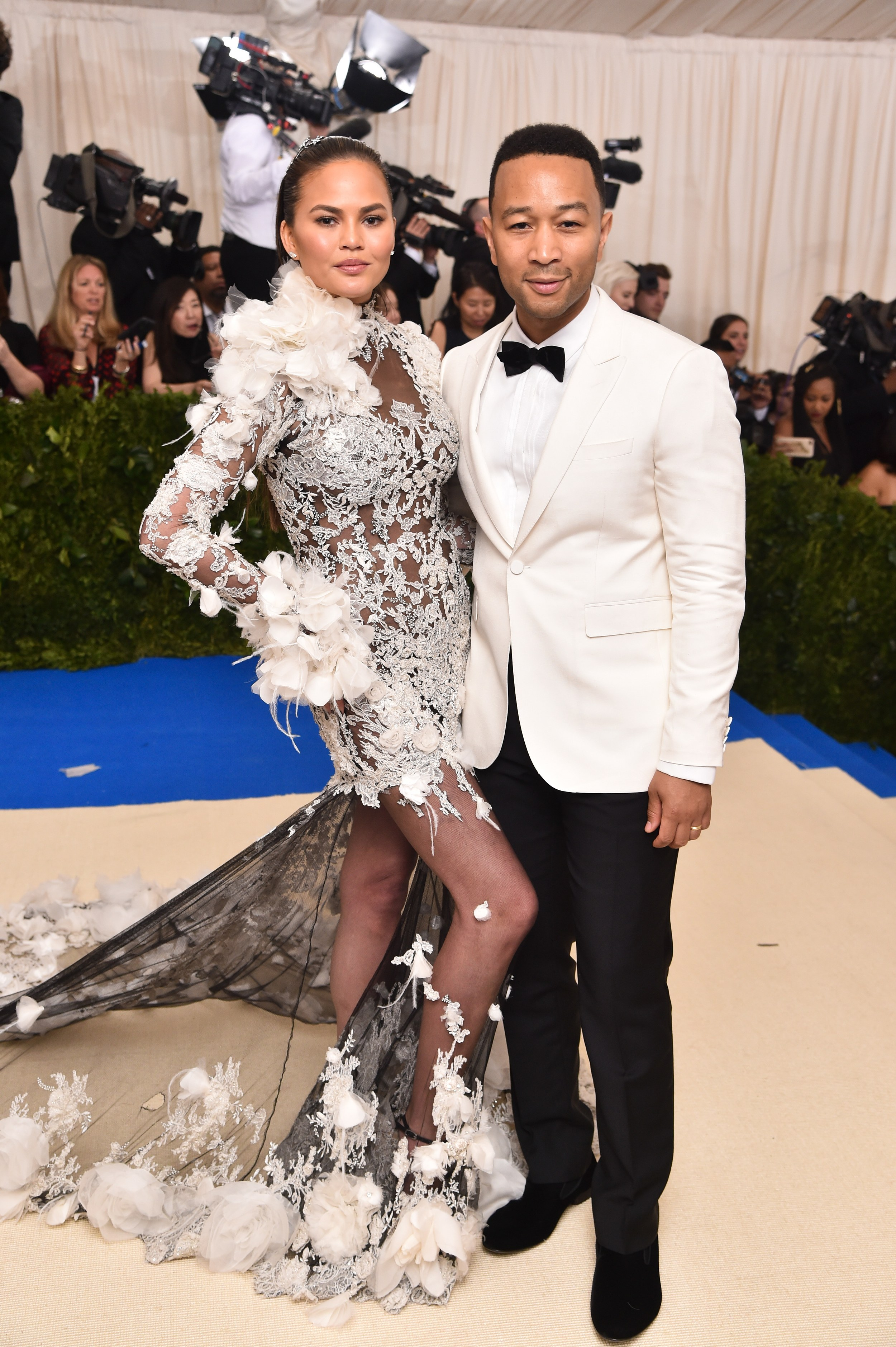 Chrissy Teigen in custom Marchesa and John Legend in Burberry