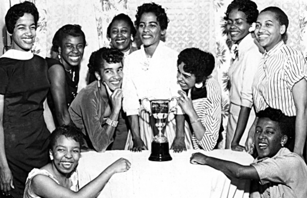Group celebrating Hazel Hayes win as first Alberta Association for the Advancement of Colored People (AAACP) Queen, Calgary, Alberta. July 1958