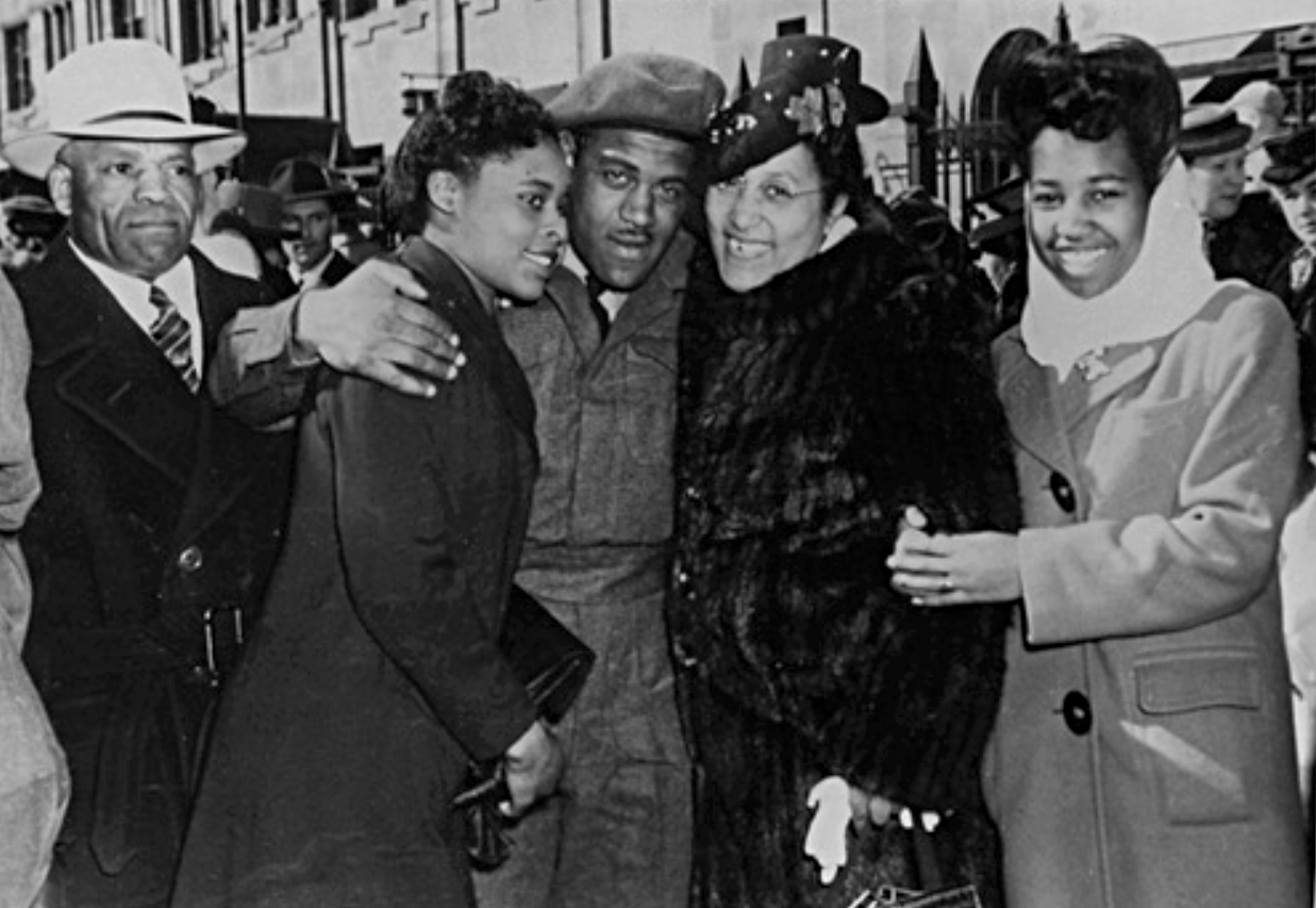 Corporal Theodore 'Ted' King met by his parents on his return to Calgary, Alberta. L-R: John King, Della Mayes (later married Ted King), Stella King, Violet King -na-4987-5