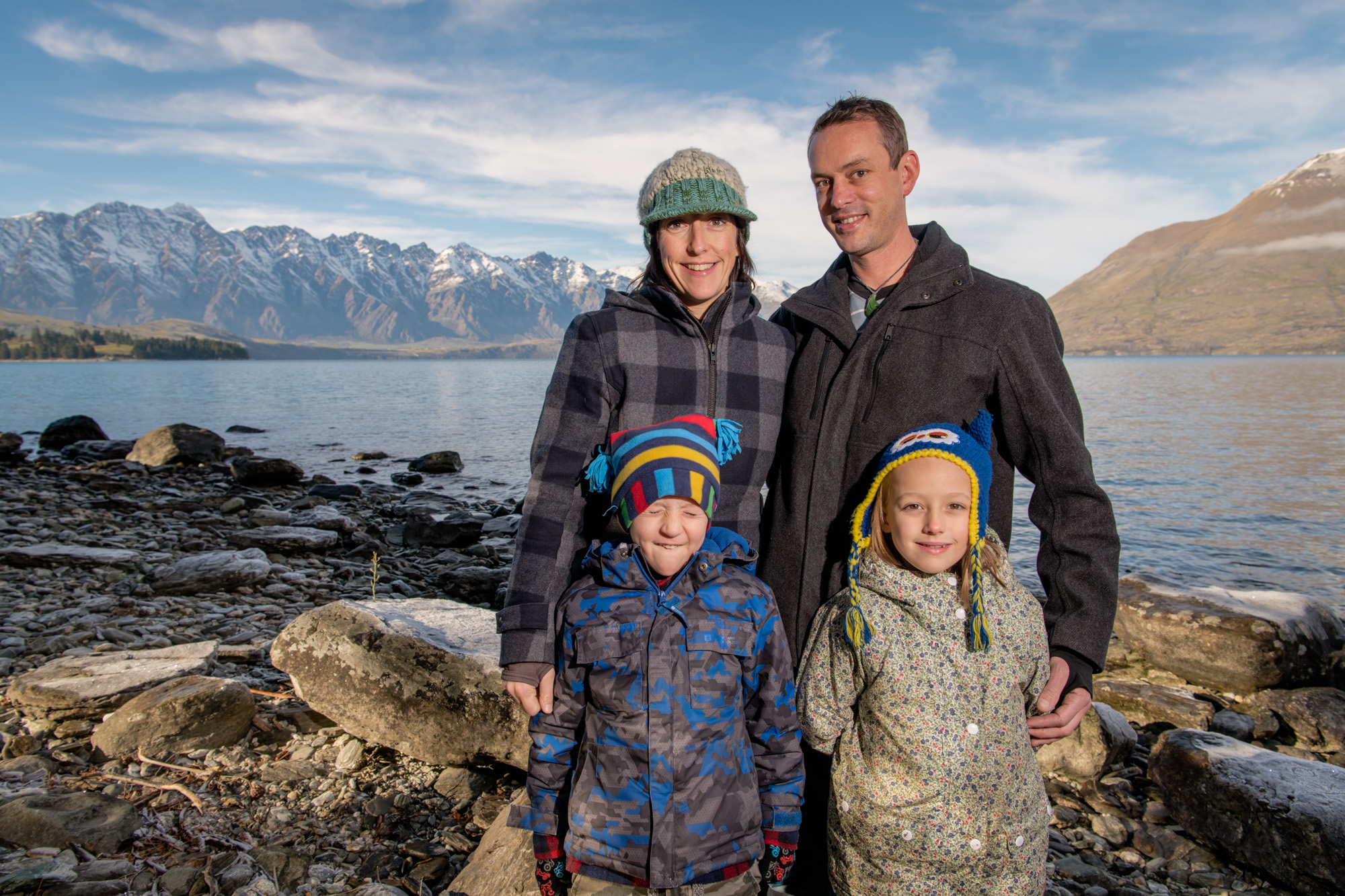 Family portraits at the shore of Lake Wakatipu, The Remarkables in the background