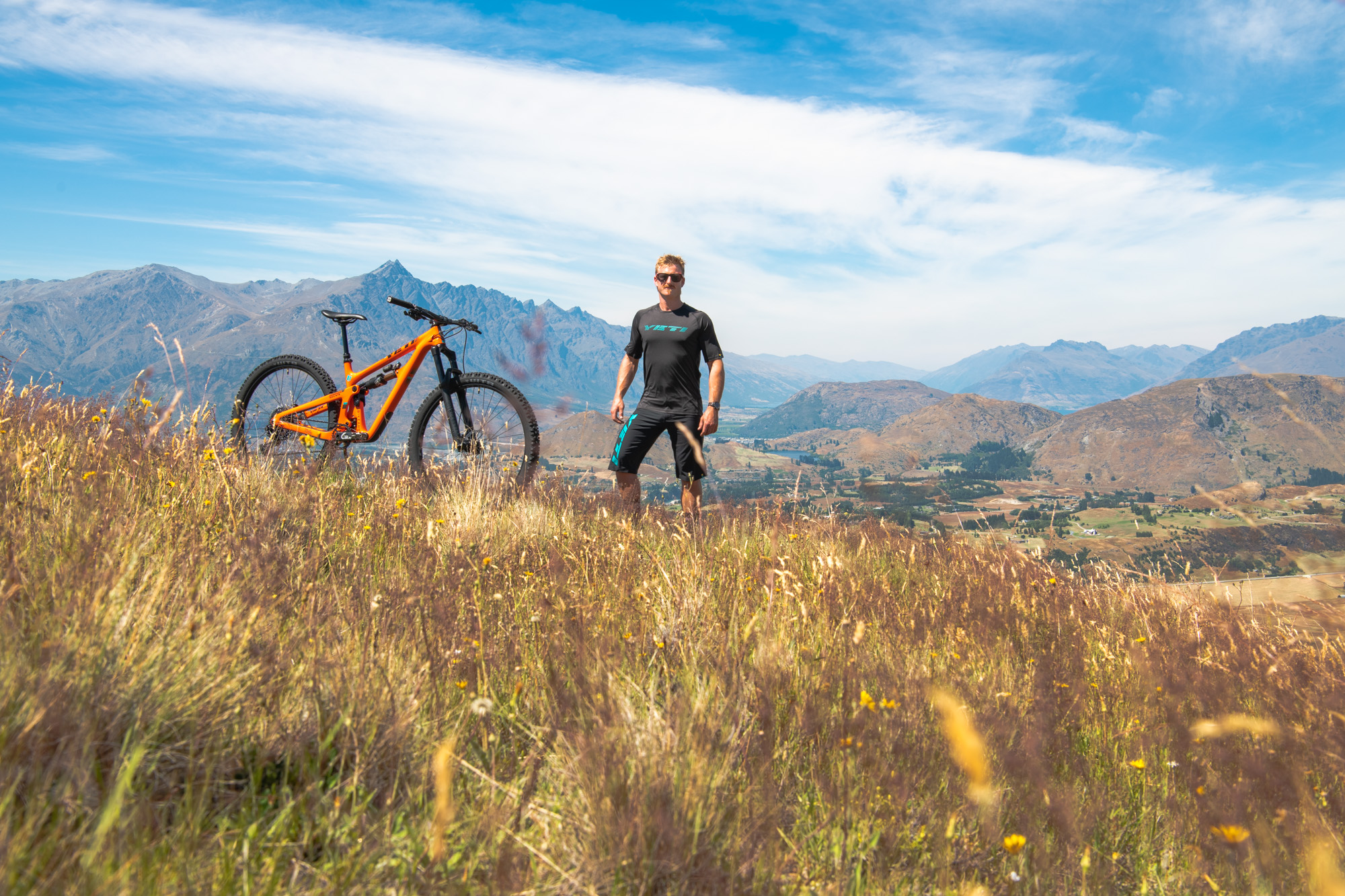 Jimmy Pollard standing high above his home in Queenstown with his 2019 Yeti SB150