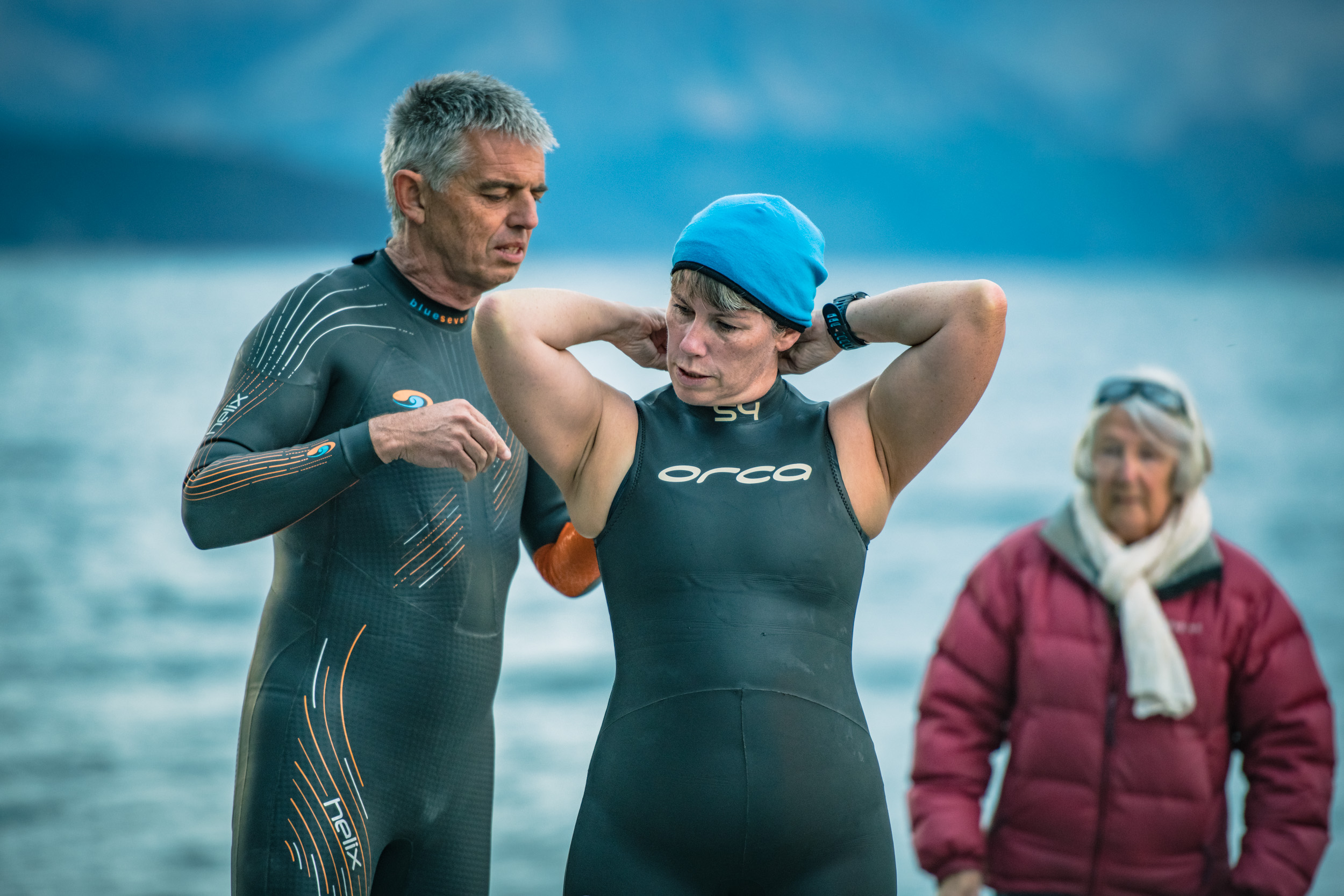 Zipping up wetsuits at Lake Wanaka - Professional Sport Event Photography