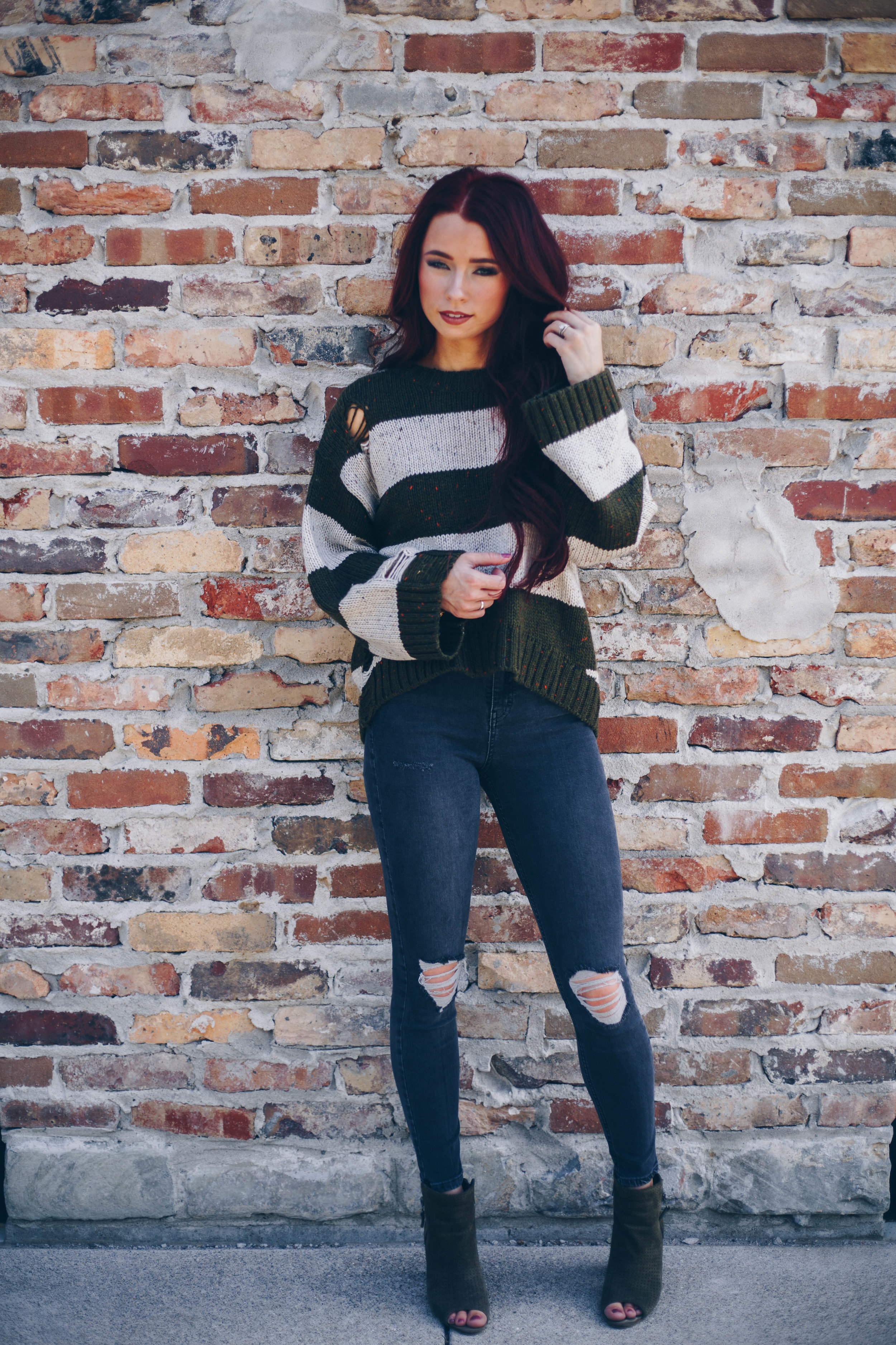 This sweater has speckled flakes which makes it unique. Also love anything olive. I paired with a charcoal jean just for a different look.  Click here  for full details.