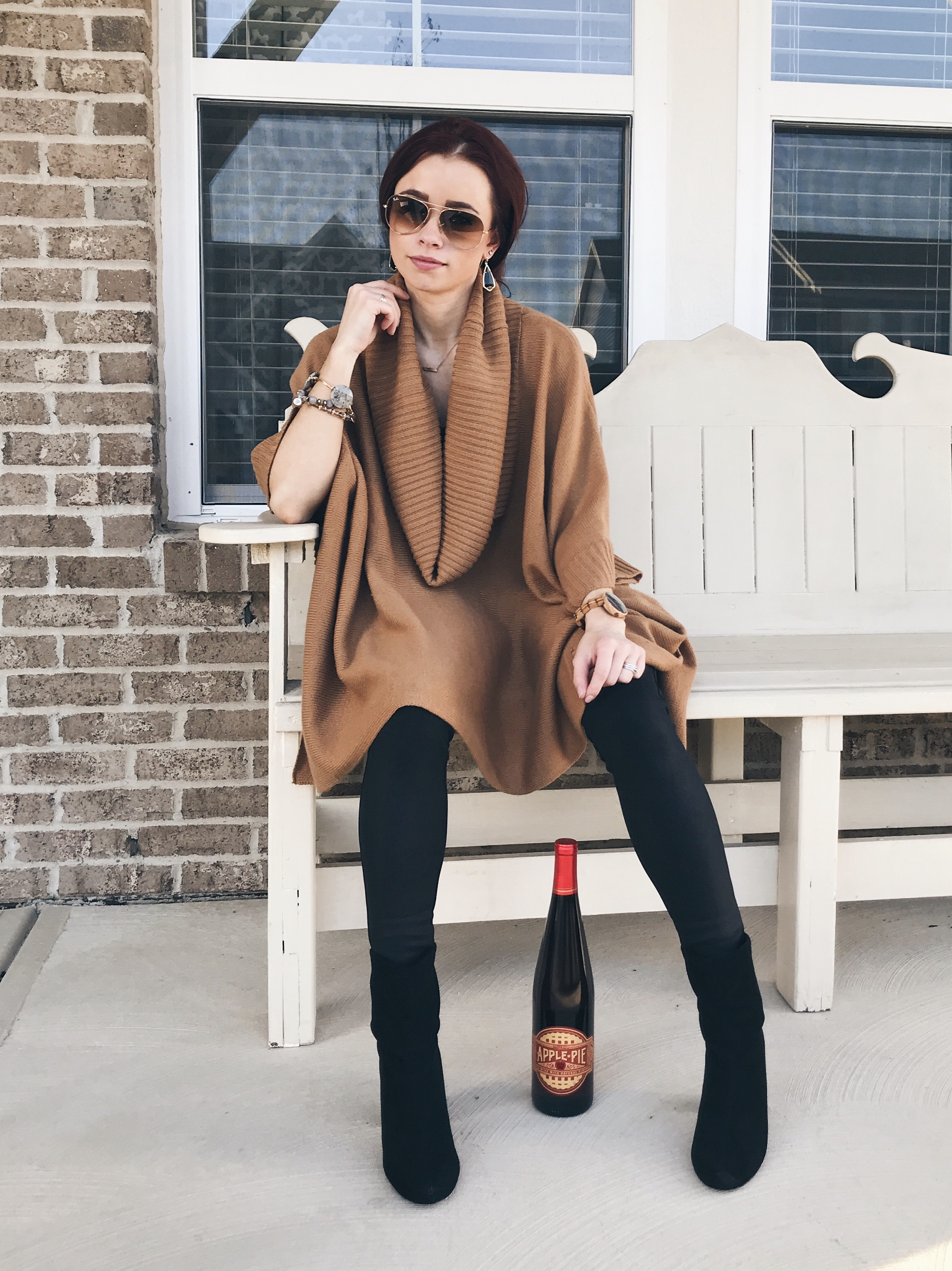 When I wore this oversized poncho kind of top, I wasn't feeling well and pretty sure I drank that whole bottle of wine. I paired this with leather leggings from Express. This top is from H&M probably three years ago.