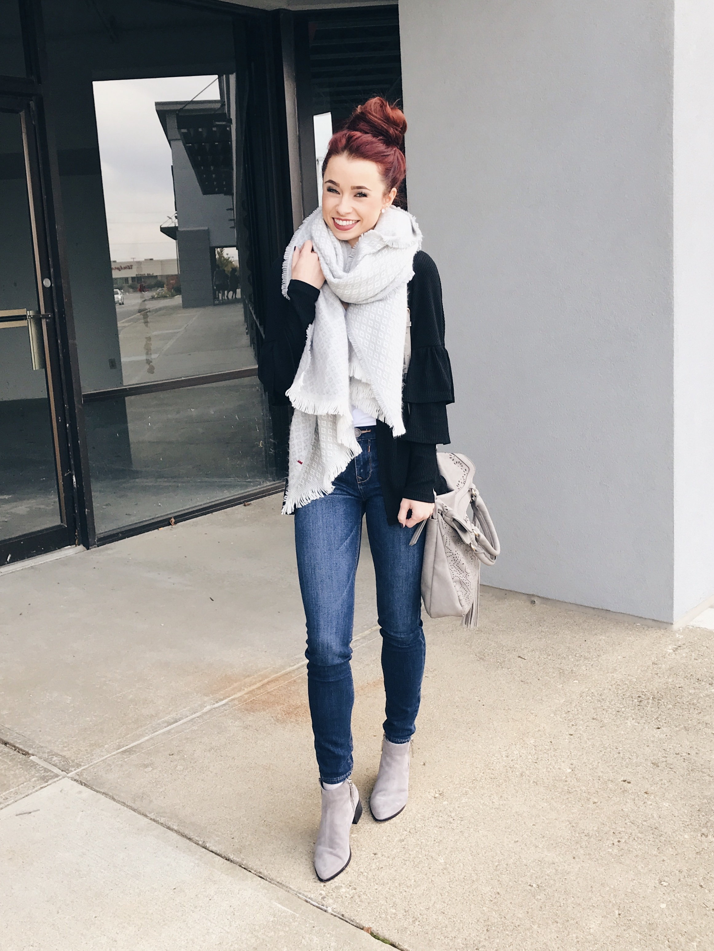 Chunky scarves for days. Invest in a basic color so you can wear it with everything. My ruffled cardigan is from RaeLynn's and I love it. Paired with a basic denim and grey booties I found at Nordstrom on sale!
