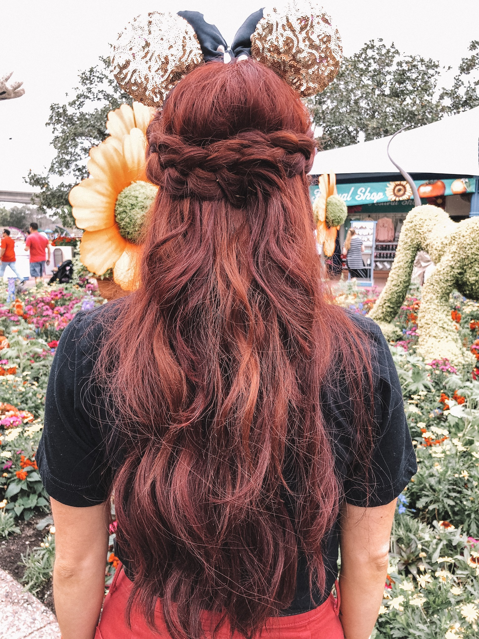 Top 5 Easy Hairstyles for Mickey Ears featured by top US beauty blog, Trendy in Indy: image of dutch braid half-up style