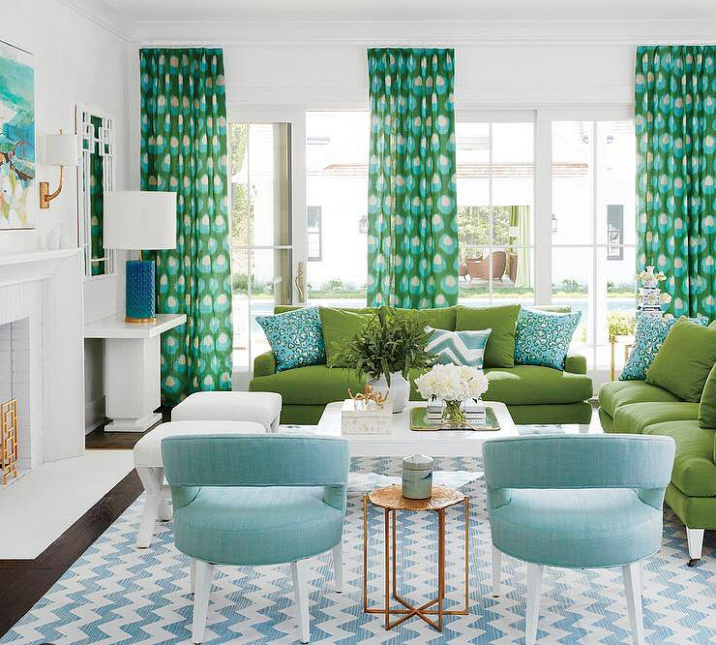 """There are so many ways that you can add color to a room without painting the walls. especially if you live in a rental. 1.) Go big! with colorful artwork. Large colorful artwork adds a pop of color and focal point to the room. Focal points are really important in the Interior design industry. It's the first thing that gets our attention when entering a room. 2.) Here's a chance to put your own personal style to a room by adding bold colorful Throw pillows or throw blankets. pair pillows in threes or just two flanking each side of the sofa. 3.) Invest in a colorful sofa or reupholster your existing sofa for a fresh colorful new look. 4.) Fill your home with plants. Adding plants or flowers around your home can bring interest and color to your home. """"Tip"""" plants are a great way to hide any cord running along the floors. 5.) Try incorporating bold and colorful drapery for vertical interest. by placing the drapery rod higher towards the ceiling, it makes the ceiling feel higher than they actually are."""