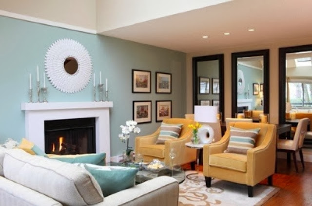 1.) Add crown molding or picture rail to make the ceiling height seem lower.   2.) Wallpaper is a great way to trick the eye of a lower ceiling and adds a designer look to your space.  3.) Adding decorative elements to the room, for example use beams to create visual interest or add shiplap or wood panel for a little texture.  4.) Less expensive trick is to add task light throughout the space. (table lamps, floor lamps, track lighting) lighting will lead the eyes ways from those super high ceilings.  5.) Designers use this trick all the time. paint a darker color on the ceiling. Painting is a simple diy project that most people can do on themselves.