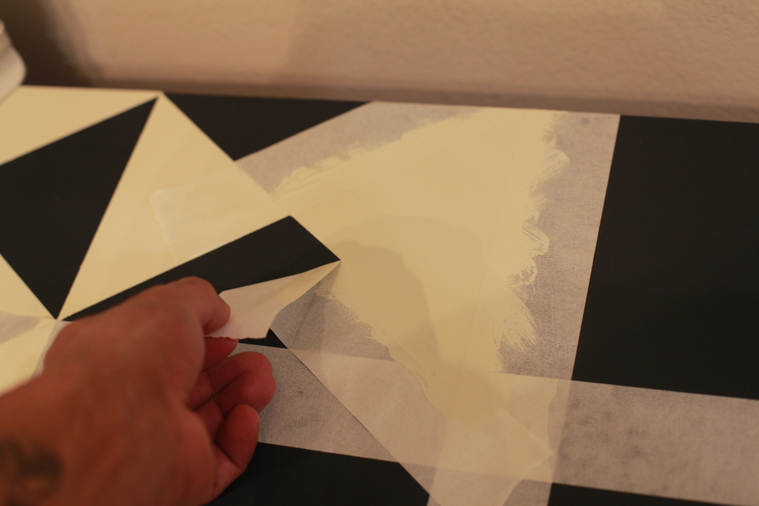 Now it's time to have some fun! Start removing the painters tape to see your beautiful work!