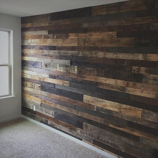 Project #4 DIY Pallet Wall:   Add a touch of rustic home decor with a DIY wood pallet wall. Definitely feels cozy with this bold statement wall. looks great and adds some beautiful texture to the room.  Credit: pionik.com
